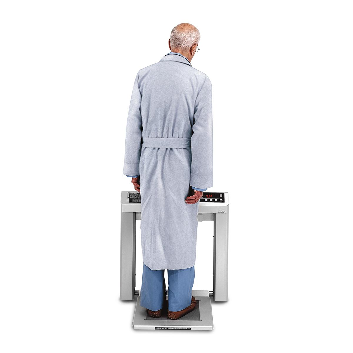 Patient standing on Stow-A-Weigh Stand-on Scale