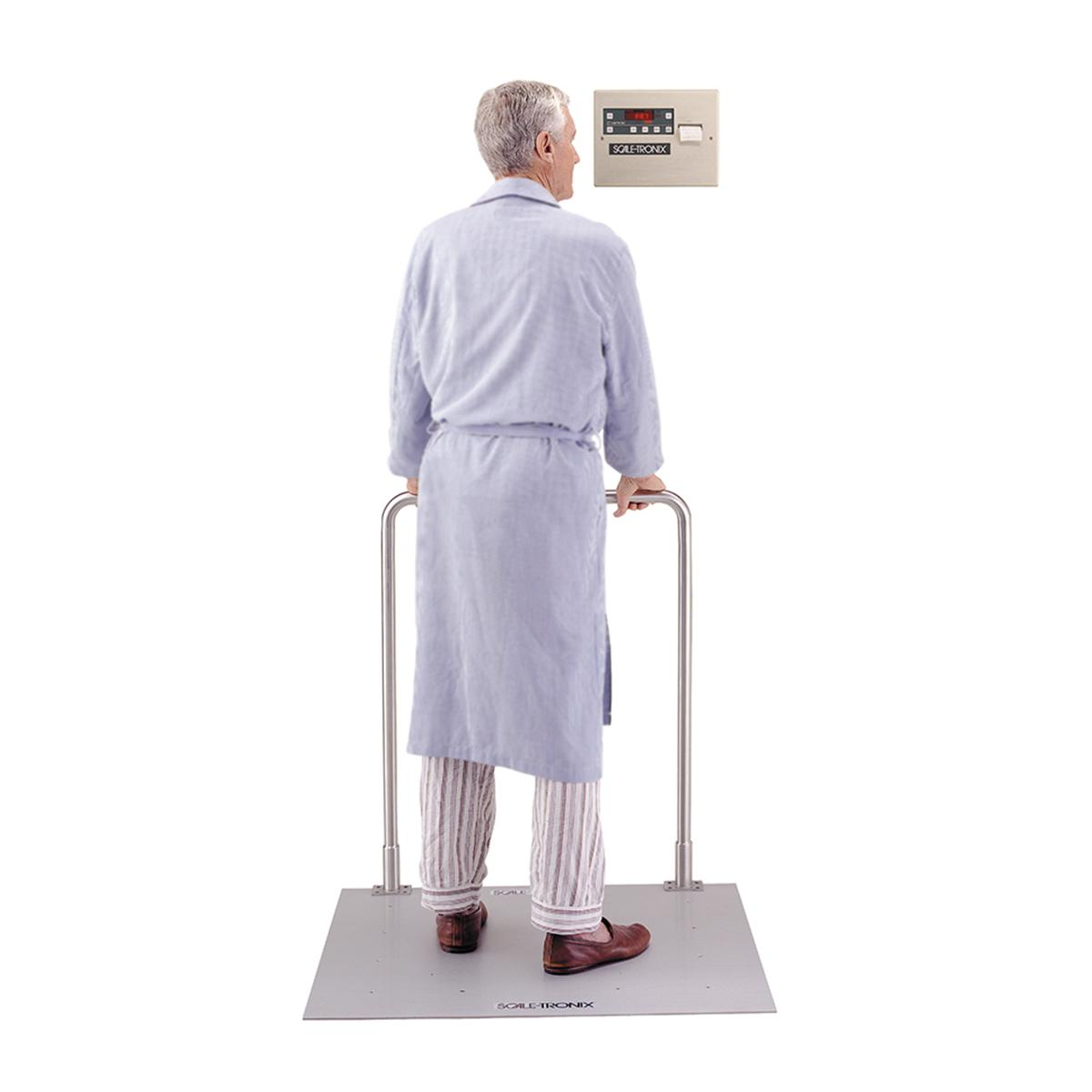 Patient standing on  Scale-Tronix In-floor Scale