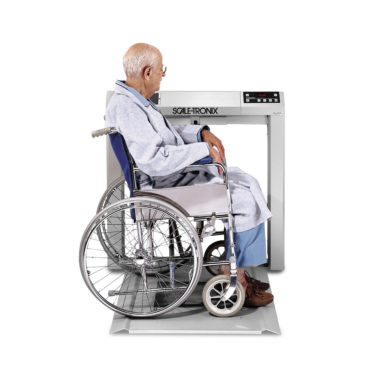Patient in wheechair on Stow-A-Weigh Wheelchair Scale