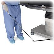 Needle Triever™ Device being swept under OR table by nurse