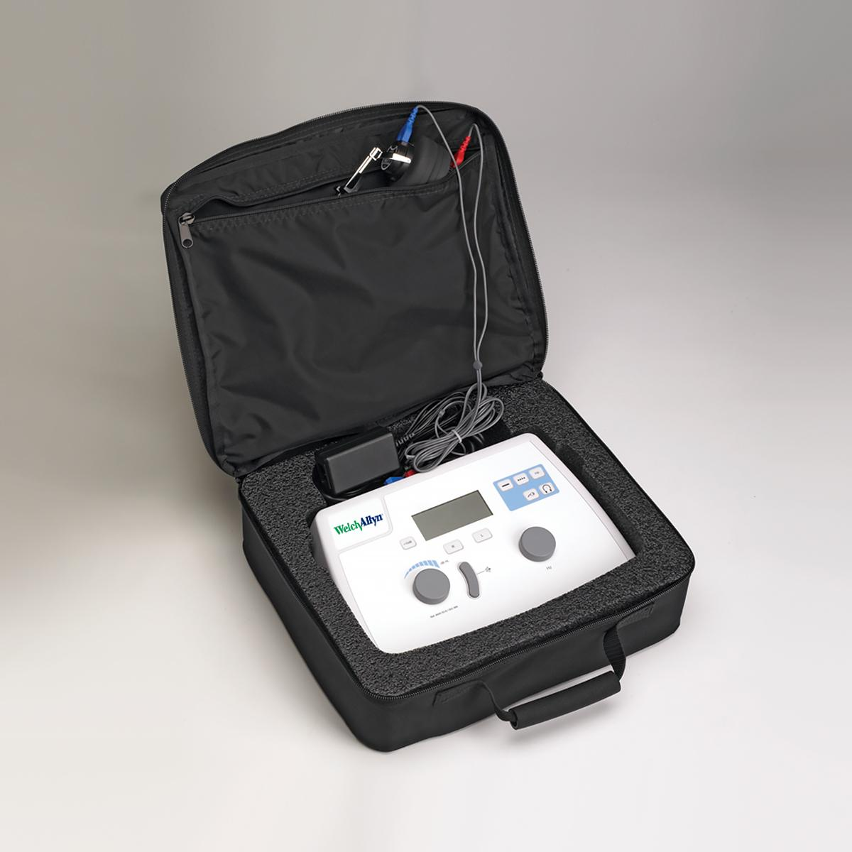 The Welch Allyn AM 282 portable audiometer in its black carry case, which features zippered pockets for cord storage.