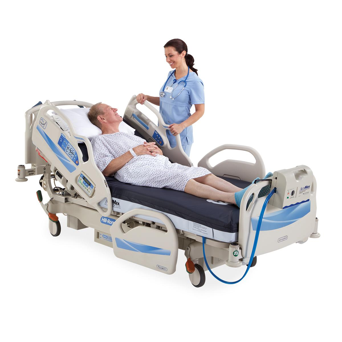 Patient reclines in bed, talking with his clinician at the bedside