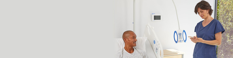 Nurse using the Voalte® Nurse Call app in the patient room