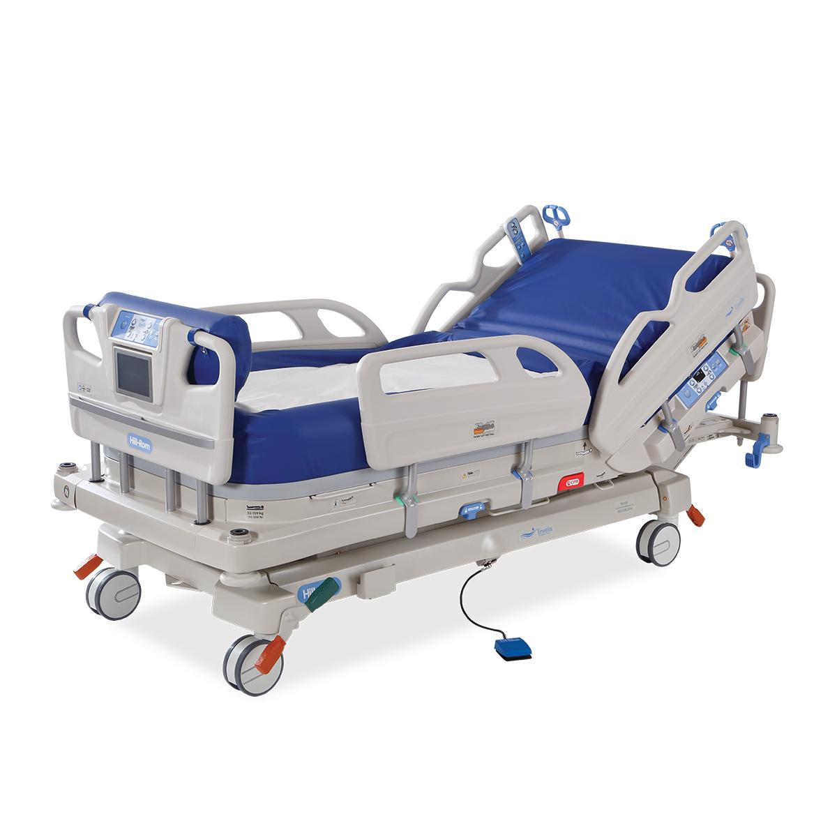 A Hillrom™ Envella therapy bed with an air-fluidized surface. The head position is slightly inclined and the siderails are up.