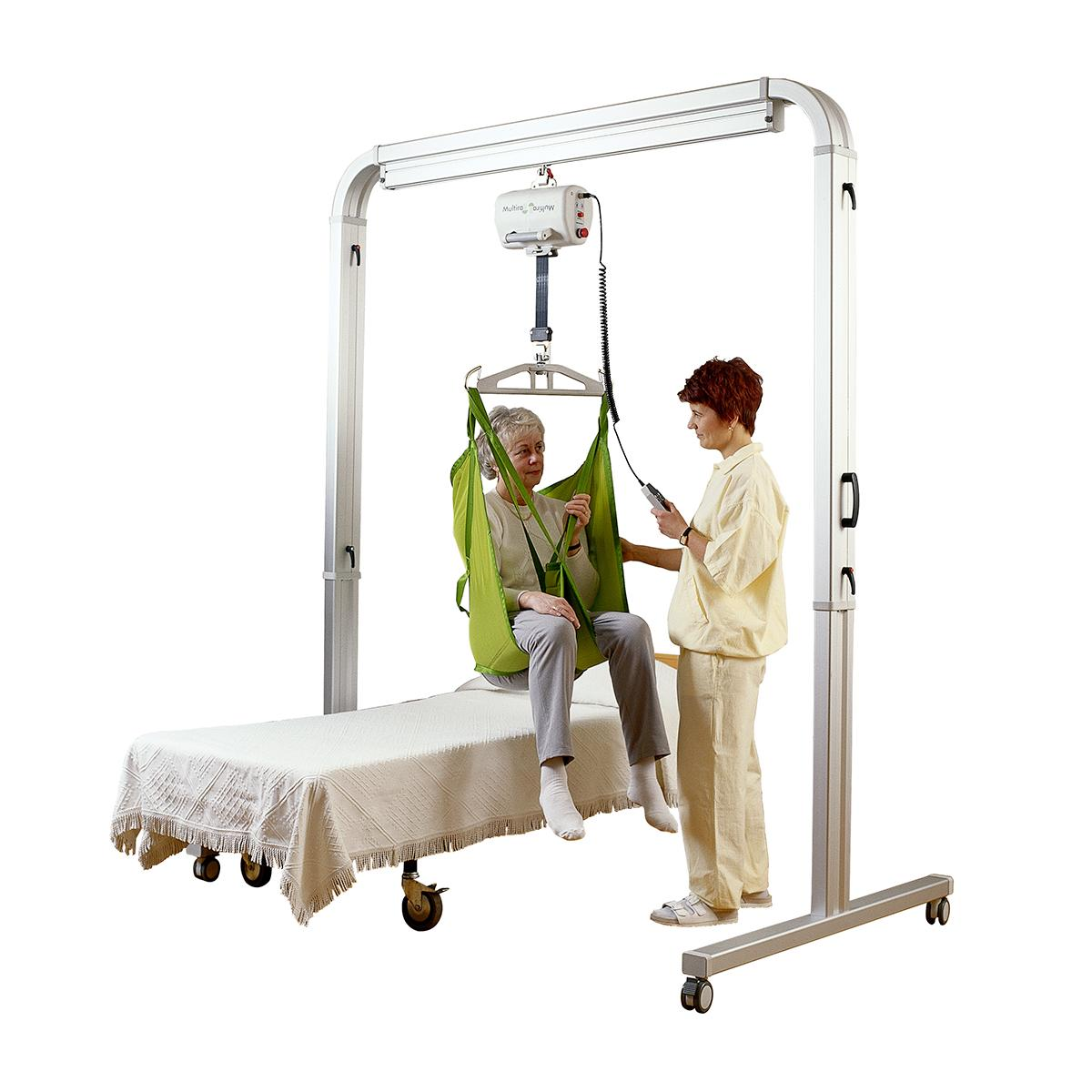 A clinician helps move a patient in a seated position using a FreeSpan straight rail lift system
