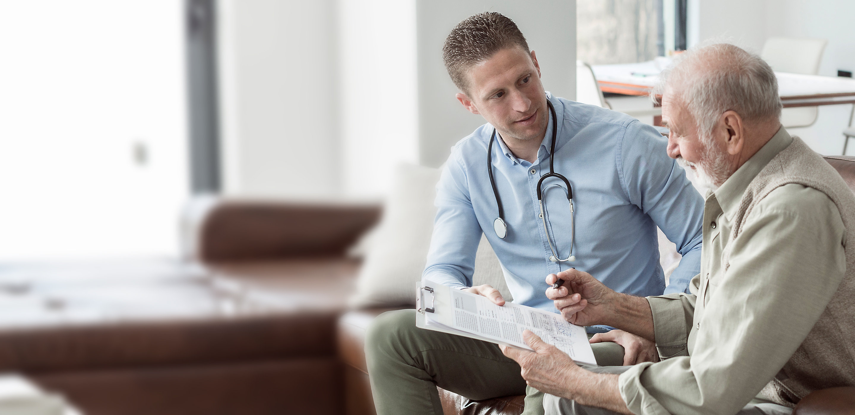 Doctor meeting with patient - Hillrom Financial Services