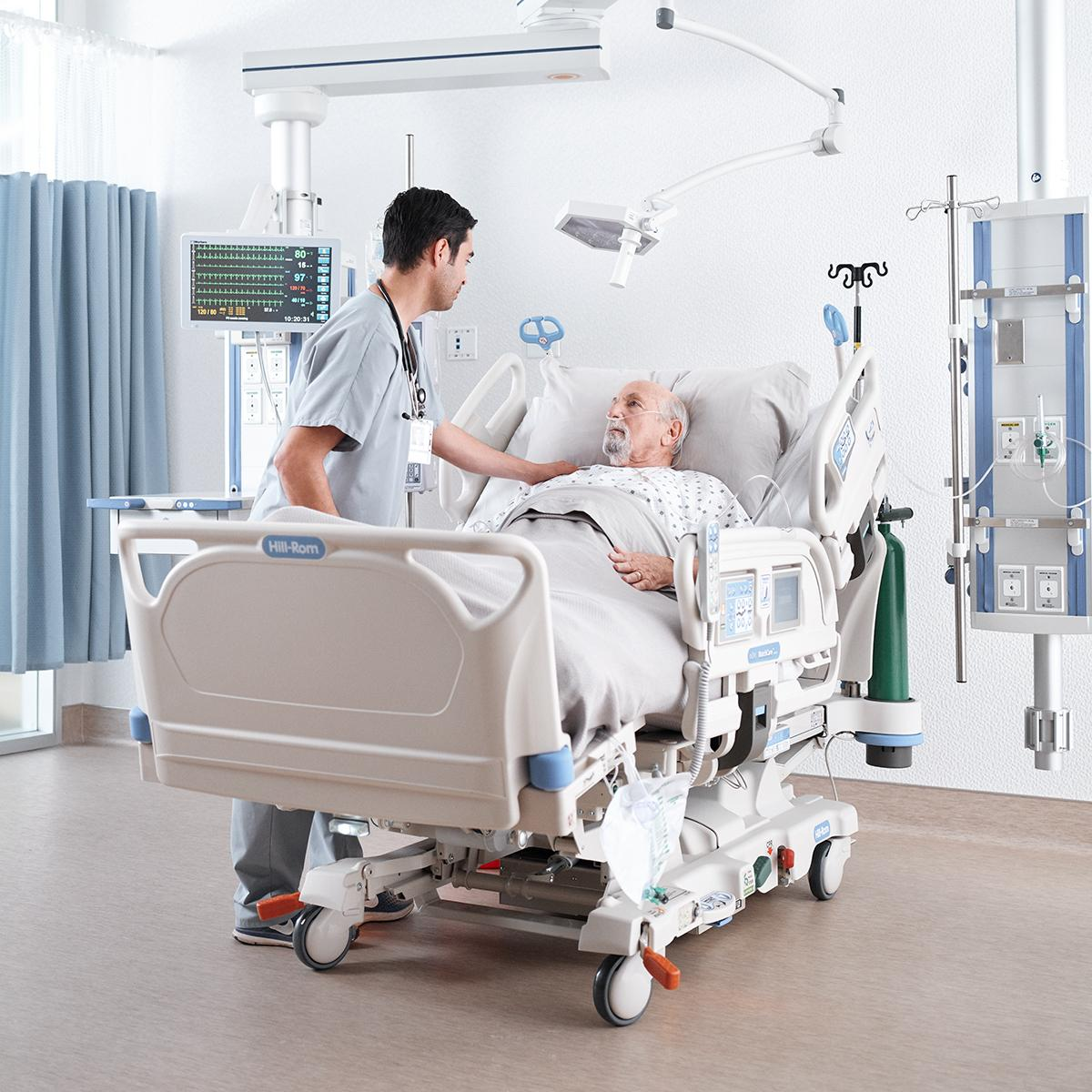 Patient in the ICU being comforted by his clinician