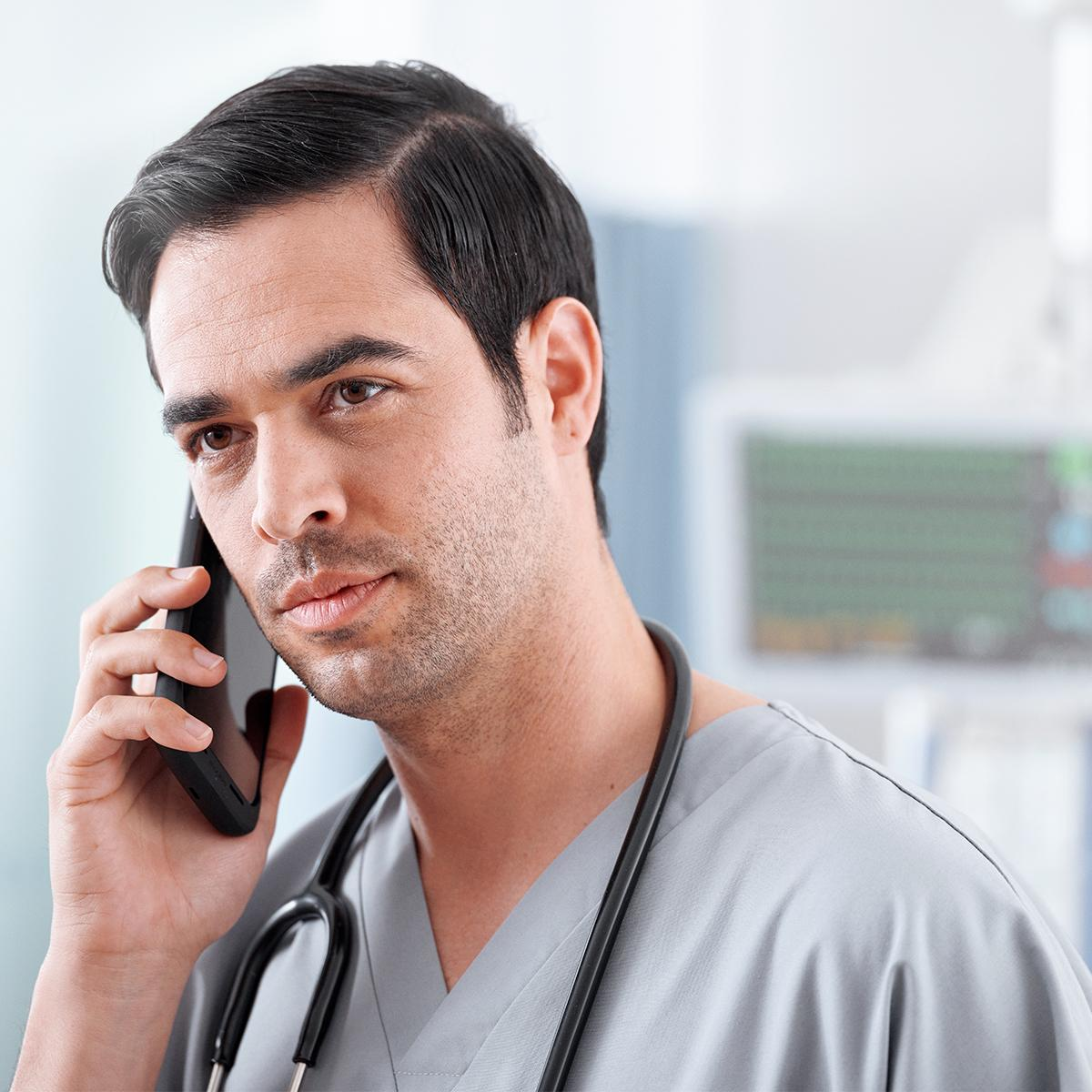 Nurse holding a smartphone to his ear