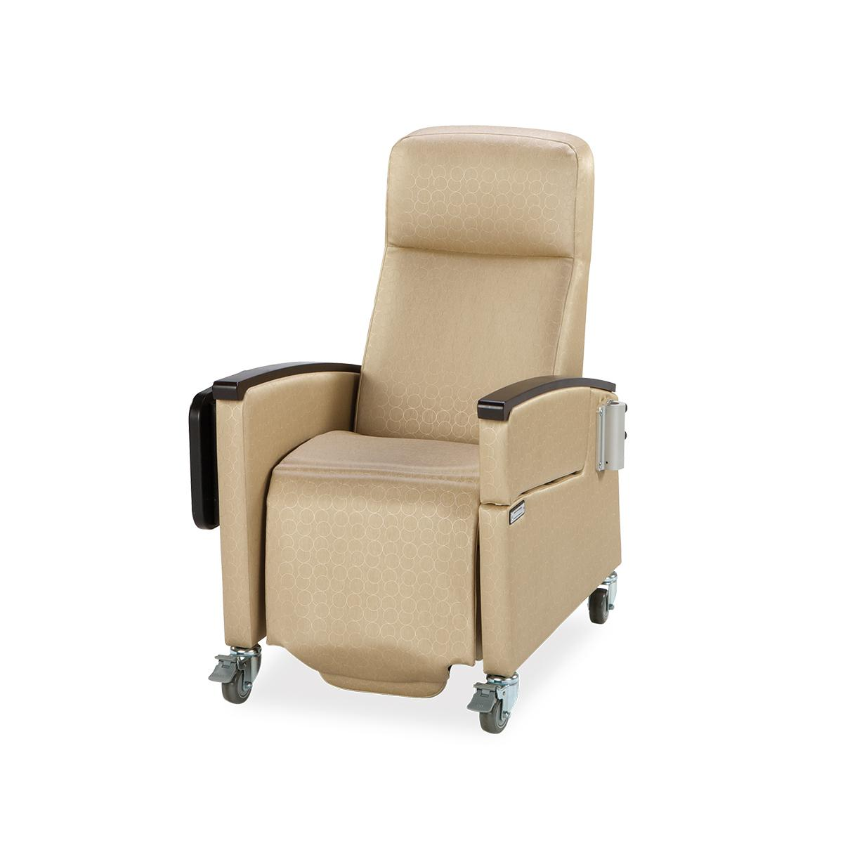 A tan Art of Care Junior Recliner, featuring a fold tabletop, caster wheels with foot chock and armrests