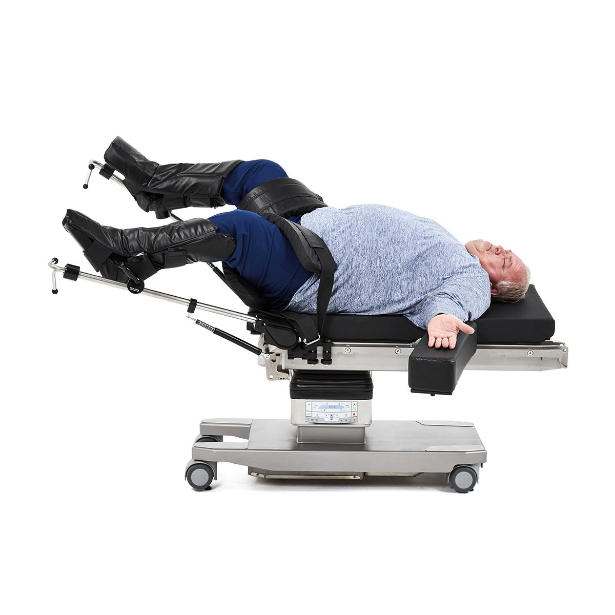 Bariatric patient in lithotomy position on surgical table with legs in stirrups.
