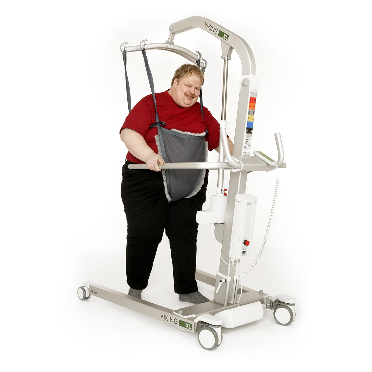 A patient is supported while walking with the Viking XL mobile lift