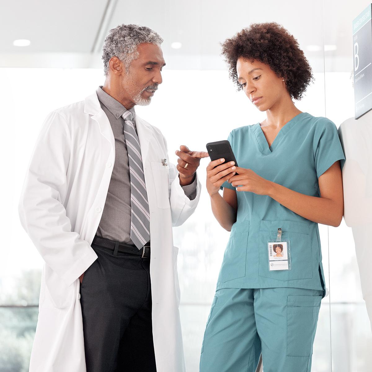 Nurse and clinician looking at a smartphone