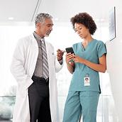 Doctor and nurse using smartphone