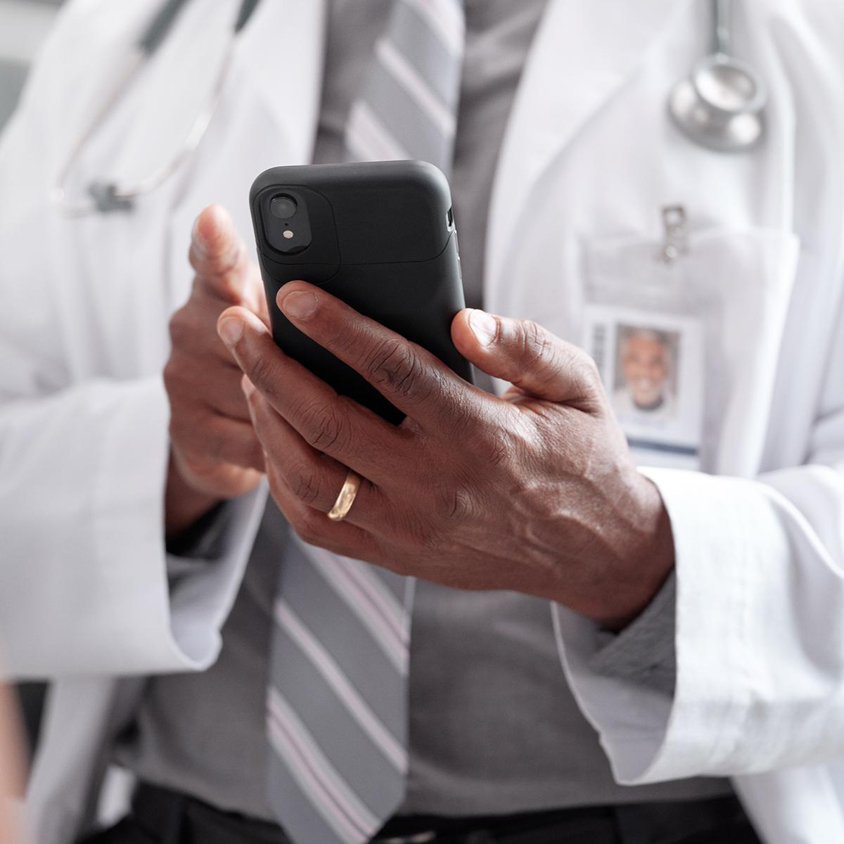 Physician holding smartphone