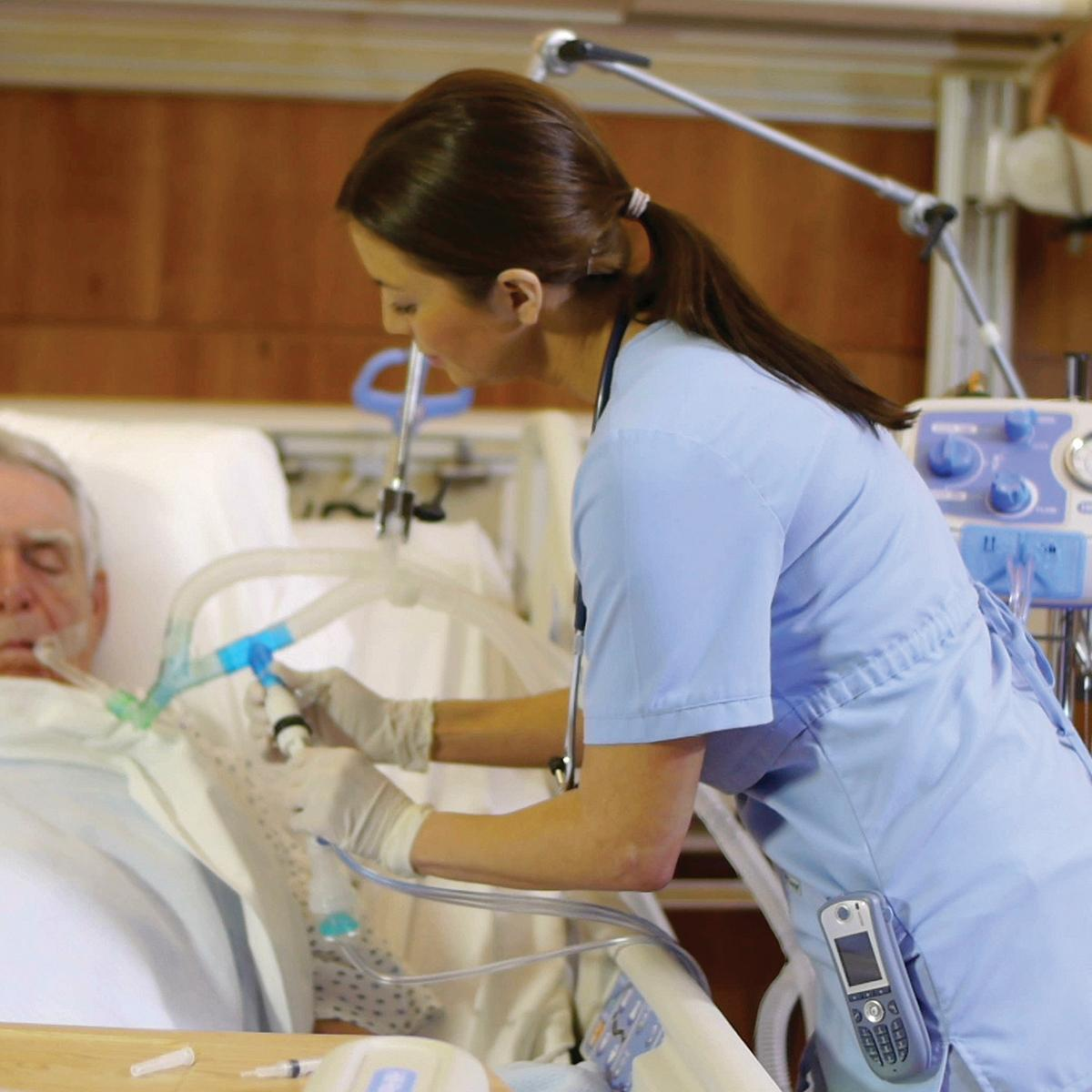 A clinician connects the MetaNeb system to administer therapy to a patient who has been intubated