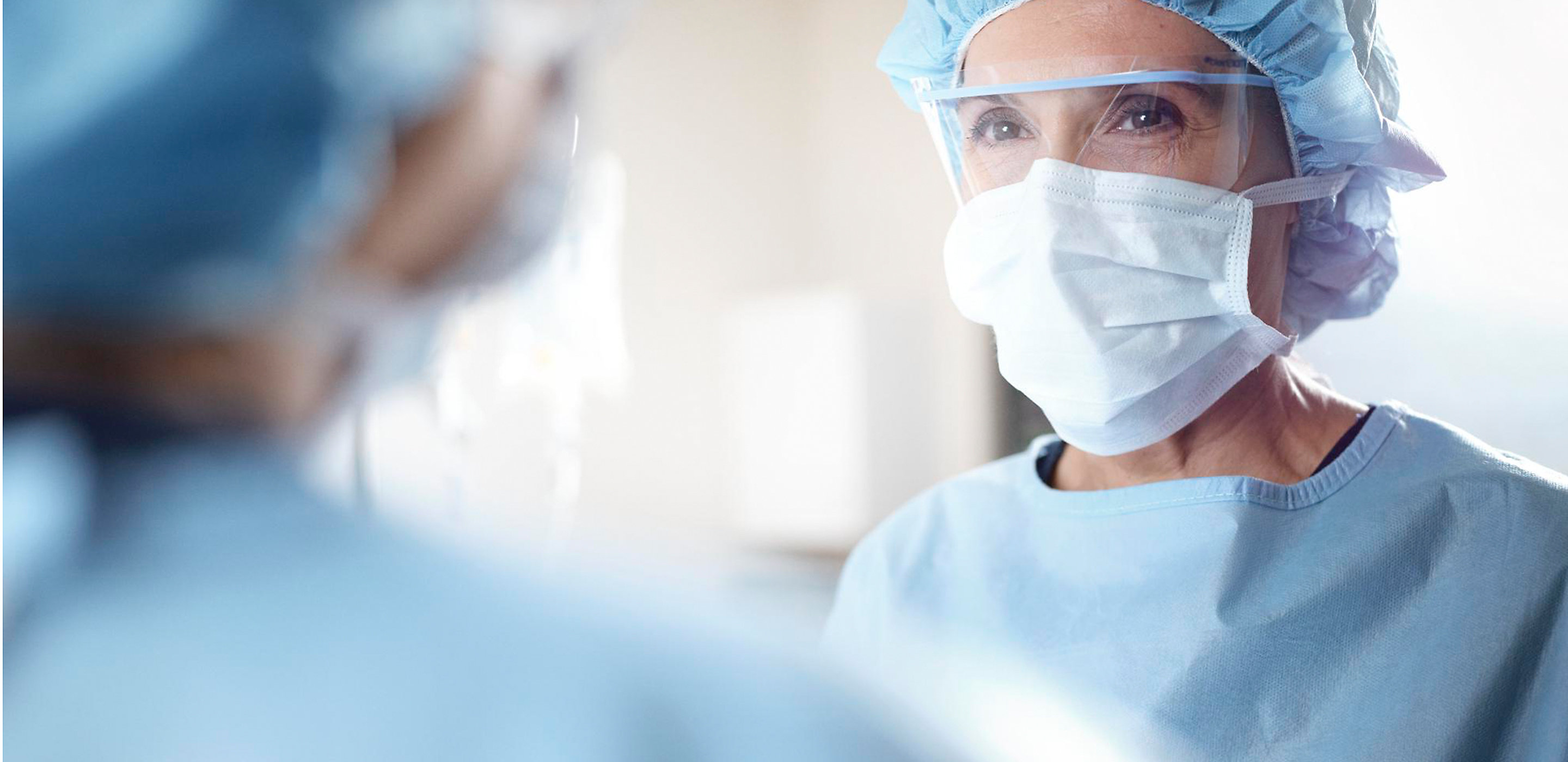 Close up of female surgeon in operating room