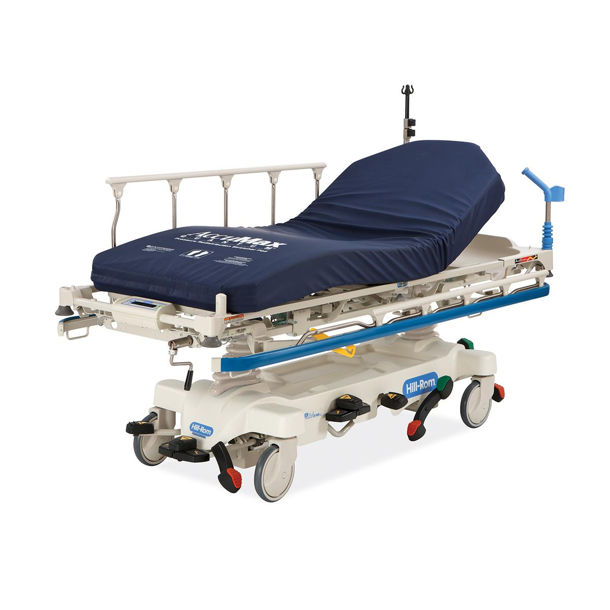 Hillrom Procedural Stretcher, diagonal view with AccuMax Quantum™ surface and blue bumper.