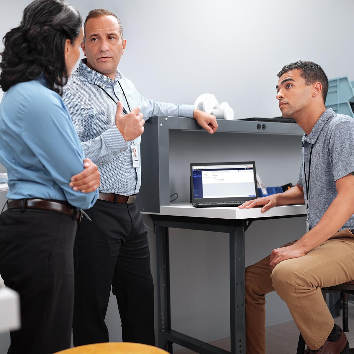 A team of biomedical engineers discusses proactive maintenance schedules using the SmartCare™ Remote Management tool.