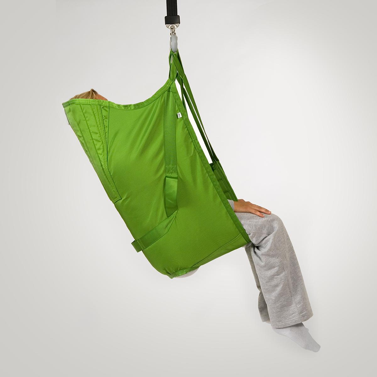 A patient sits in a soft Hillrom highback sling