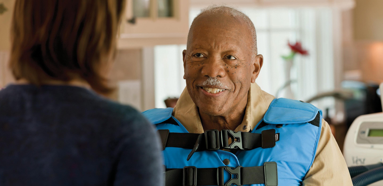 Patient wearing vest gettting treatment