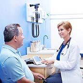 A physician reviews use of the Welch Allyn Home Hypertension Program with her patient in the office