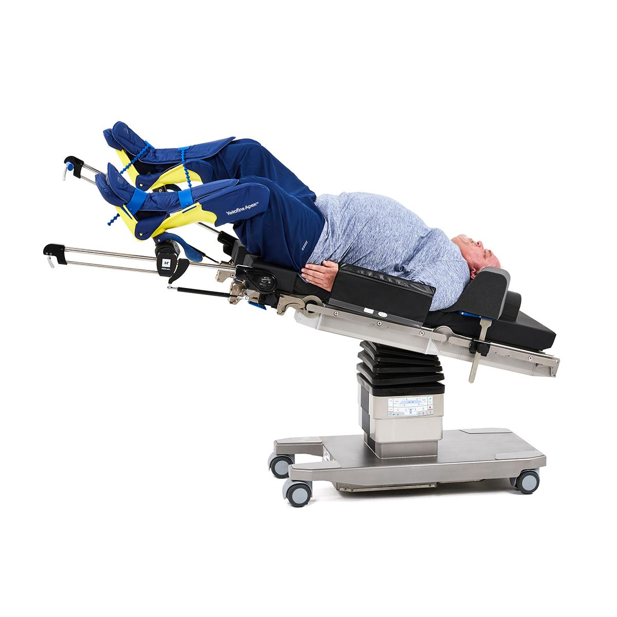 Bariatric patient positioned on Hillrom surgical table equipped with Yellofins Apex Advanced Stirrup accessories.