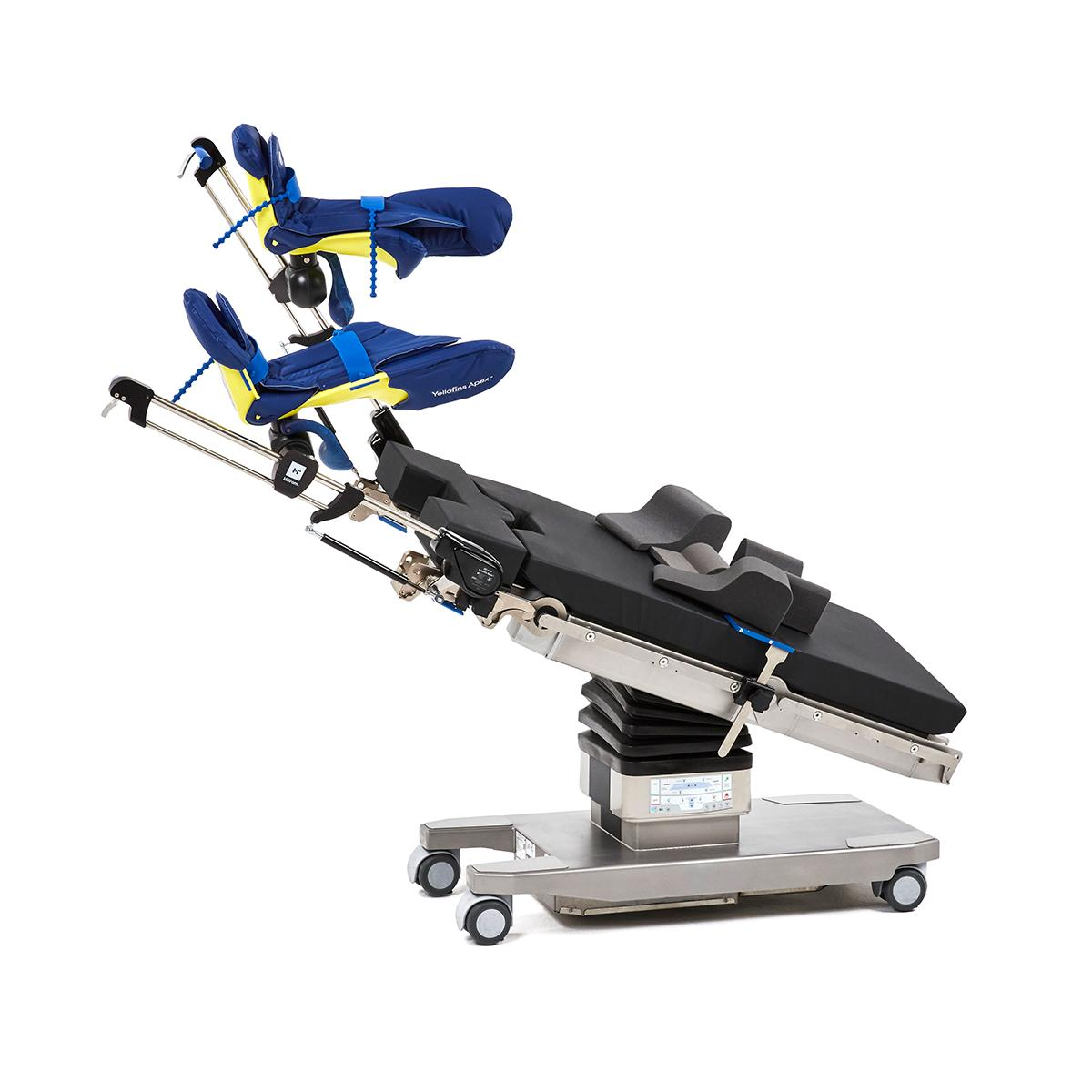 Hillrom surgical table equipped with Yellofins Apex Advanced Stirrup accessories for positioning patients.